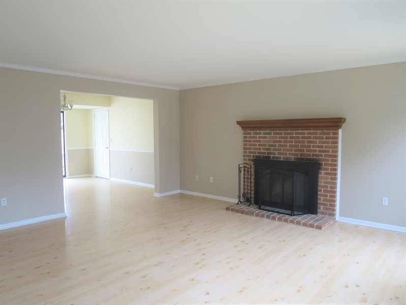 Real Estate Photography - 133 Meetinghouse Ln, Dover, DE, 19904 - Living room w wood burning fireplace