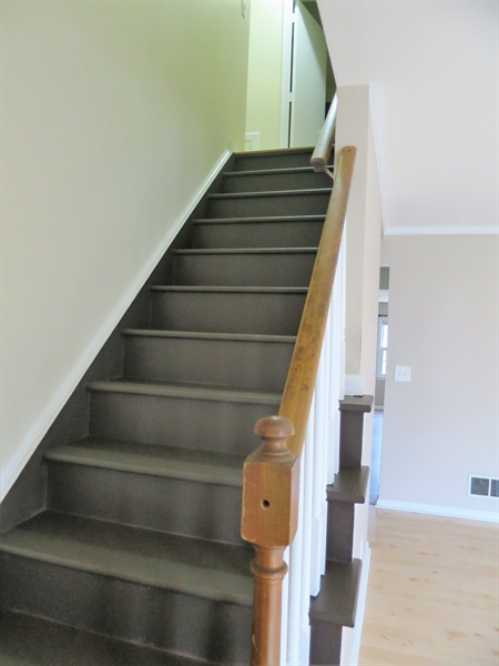 Real Estate Photography - 133 Meetinghouse Ln, Dover, DE, 19904 - Stairs that lead to the second level
