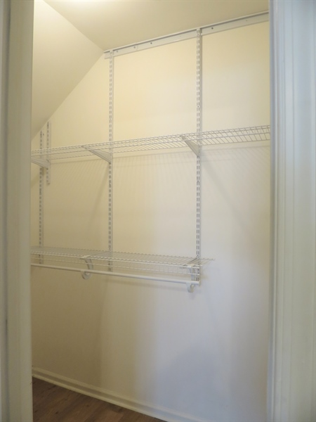 Real Estate Photography - 133 Meetinghouse Ln, Dover, DE, 19904 - Organizers in the walk-in closet