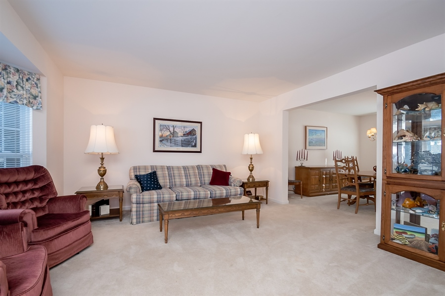 Real Estate Photography - 340 Jessica Dr, Middletown, DE, 19709 - Living Room flows to Dining Room