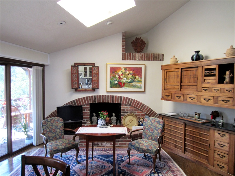 Real Estate Photography - 465 Polly Drummond Hill Rd, Newark, DE, 19711 - Breakfast room attached to kitchen with fireplace