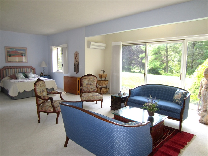 Real Estate Photography - 465 Polly Drummond Hill Rd, Newark, DE, 19711 - Lower level suite sitting area and views