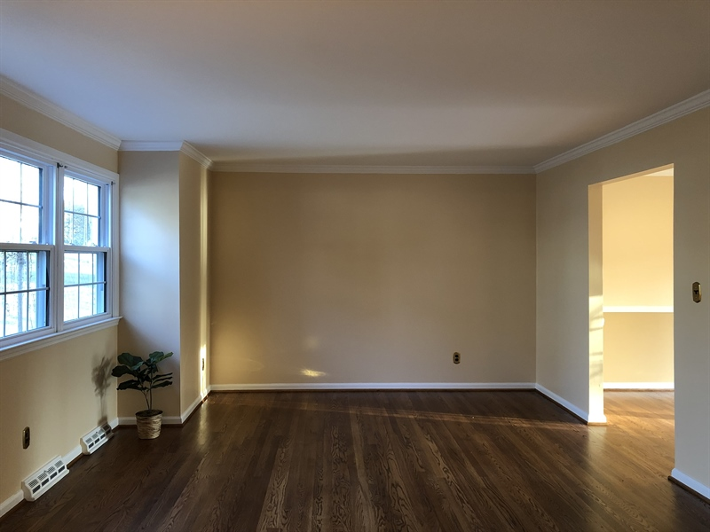 Real Estate Photography - 16 Candate Ct, Newark, DE, 19711 - Large living room has gorgeous hardwoods & trim