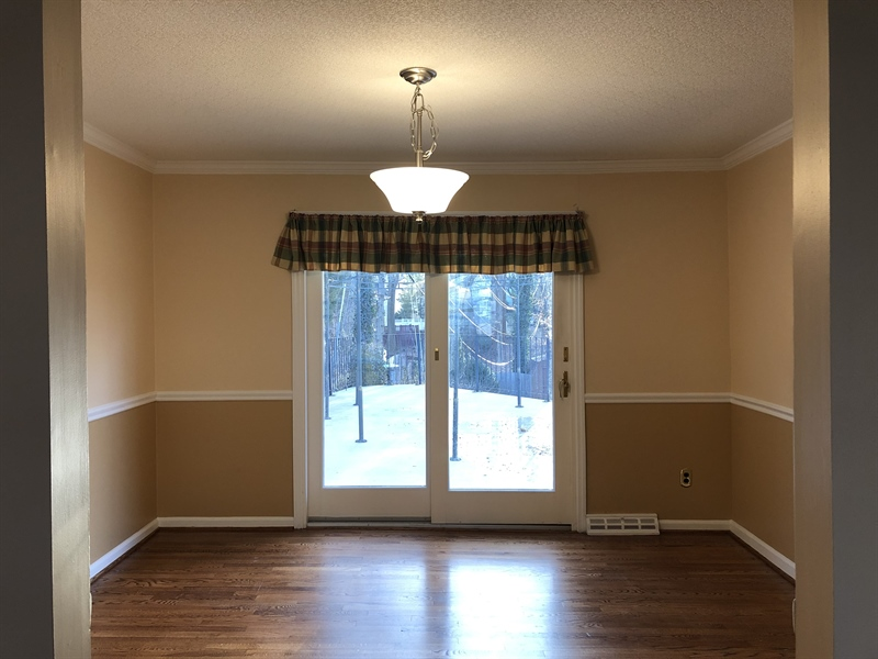 Real Estate Photography - 16 Candate Ct, Newark, DE, 19711 - Open to elegant dining room w/ sliders to patio