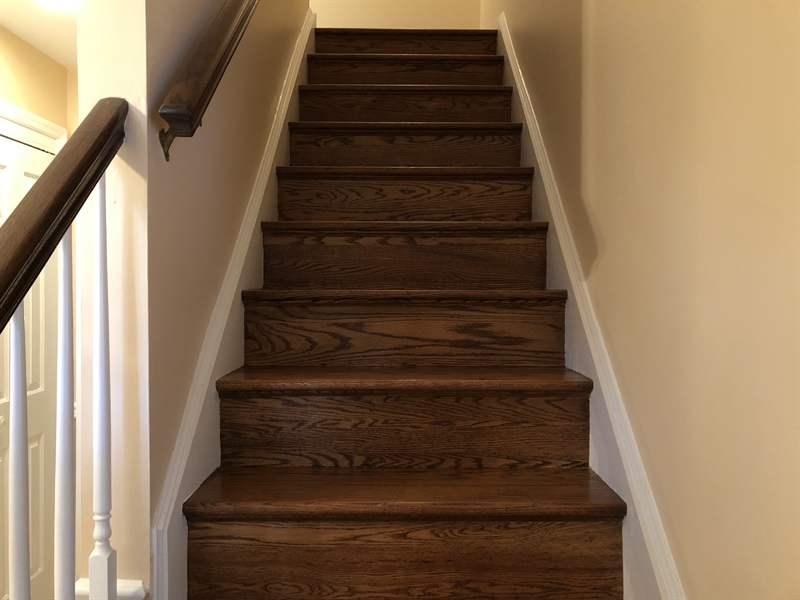 Real Estate Photography - 16 Candate Ct, Newark, DE, 19711 - Beautiful hardwood staircase