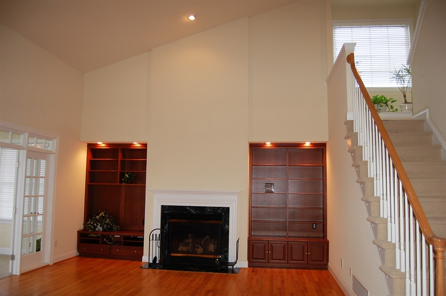 Real Estate Photography - 135 Portmarnock Dr, Avondale, PA, 19311 - Two Story Family Room with Fireplace