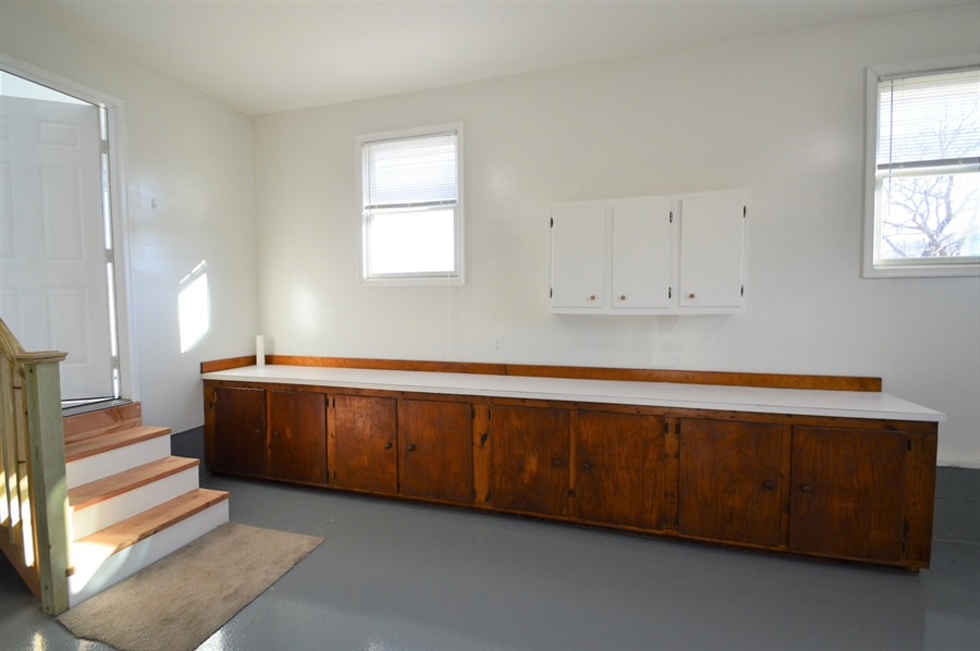 Real Estate Photography - 834 Churchtown Rd, Middletown, DE, 19709 - Garage Counter with base cabinet storage