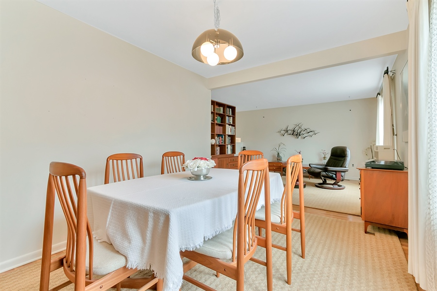 Real Estate Photography - 265 Pond Dr, Hockessin, DE, 19707 - Dining room off the kitchen and living room
