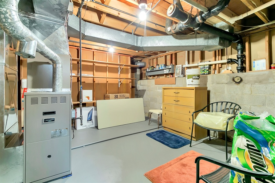 Real Estate Photography - 265 Pond Dr, Hockessin, DE, 19707 - Updated gas heat and water heater in utility room