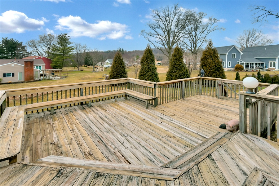 Real Estate Photography - 265 Pond Dr, Hockessin, DE, 19707 - Spacious deck off the side of the home