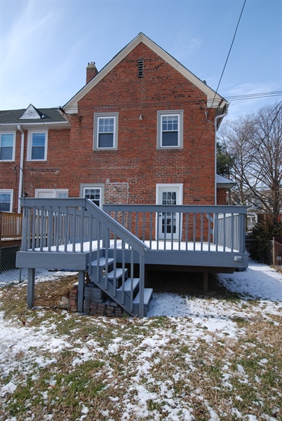 Real Estate Photography - 406 S Sycamore St, Wilmington, DE, 19805 - Fenced in backyard with deck