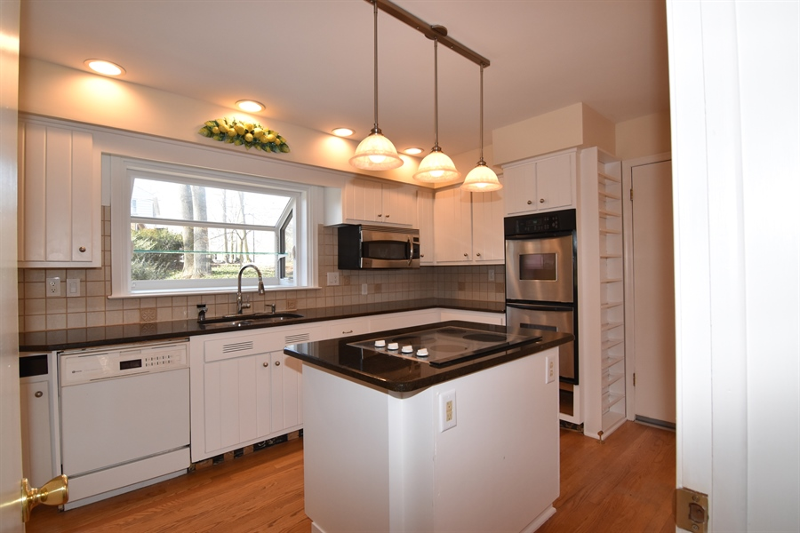 Real Estate Photography - 2 Galaxy Dr, Newark, DE, 19711 - Standing in Breakfast nook looking into Kitchen