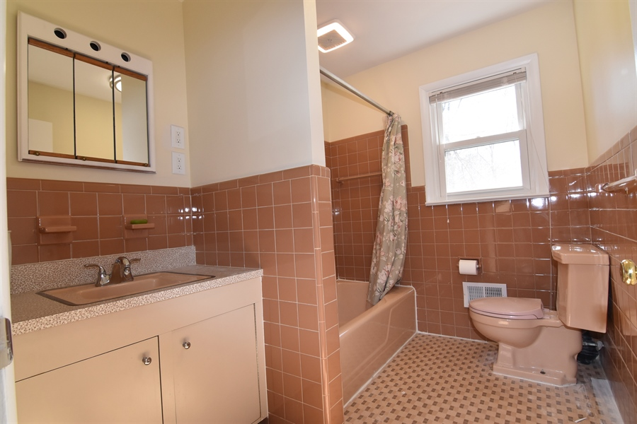 Real Estate Photography - 2 Galaxy Dr, Newark, DE, 19711 - Hall bathroom on main level