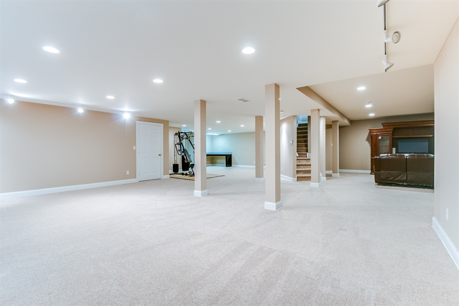 Real Estate Photography - 400 Woodale Dr, Kennett Square, PA, 19348 - Finished Walk Out Lower Level