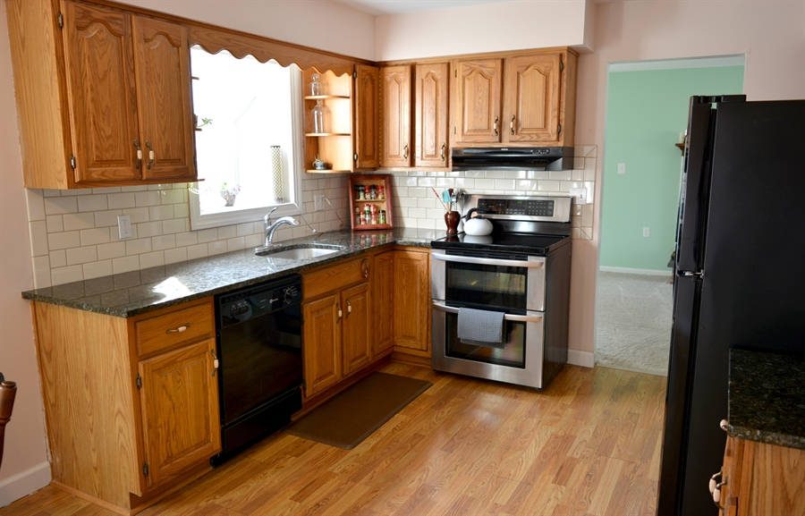 Real Estate Photography - 102 Rhett Ct, Elkton, MD, 21921 - Kitchen with Granite Countertops