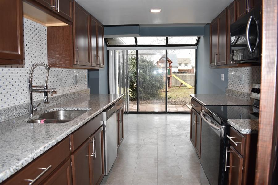 Real Estate Photography - 1267 S Farmview Dr, Dover, DE, 19904 - Kitchen, Stainless Appliances, Granite