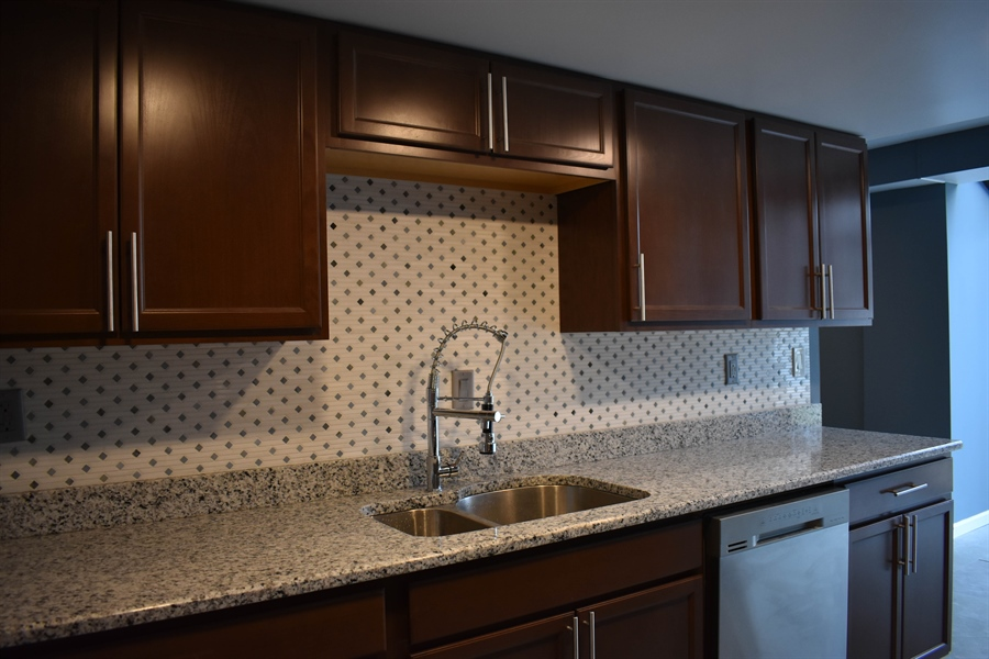 Real Estate Photography - 1267 S Farmview Dr, Dover, DE, 19904 - New Double Sink & Upgraded Faucet