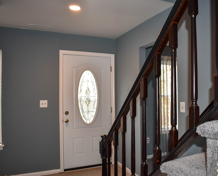 Real Estate Photography - 1267 S Farmview Dr, Dover, DE, 19904 - Foyer, New Front Door, Stained Stair Railings