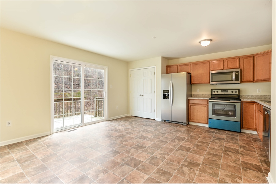 Real Estate Photography - 149 Ben Boulevard, Elkton, DE, 21921 - Huge Country Kitchen with deck to backyard
