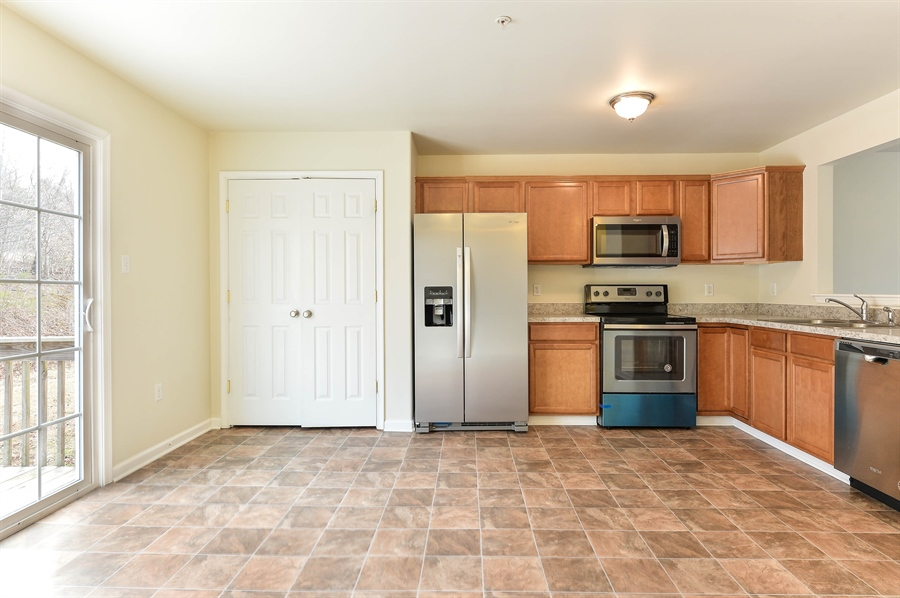 Real Estate Photography - 149 Ben Boulevard, Elkton, DE, 21921 - Spacious pantry with motion triggered LED light