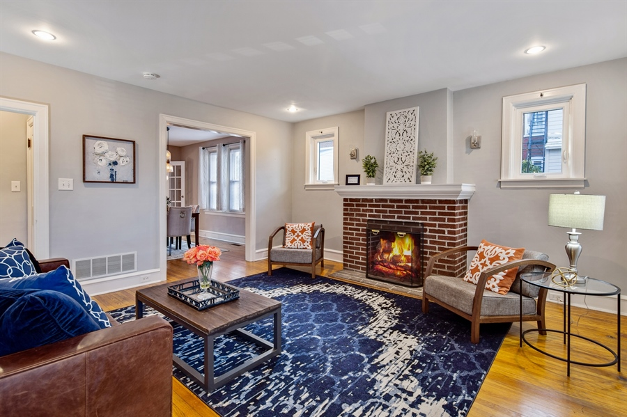 Real Estate Photography - 1324 Shallcross Ave, Wilmington, DE, 19806 - Living room with gas fireplace and wood floors