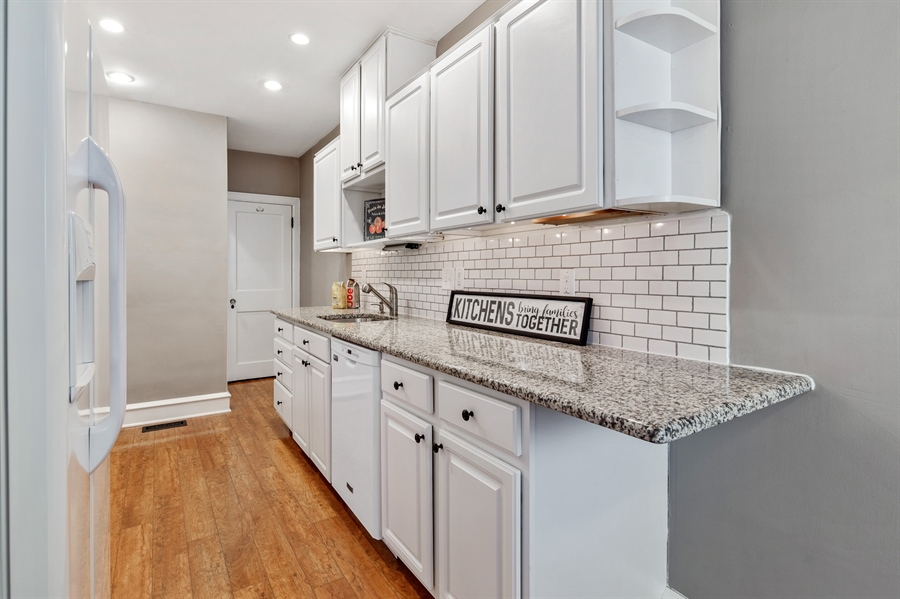 Real Estate Photography - 1324 Shallcross Ave, Wilmington, DE, 19806 - White cabinets with granite countertops