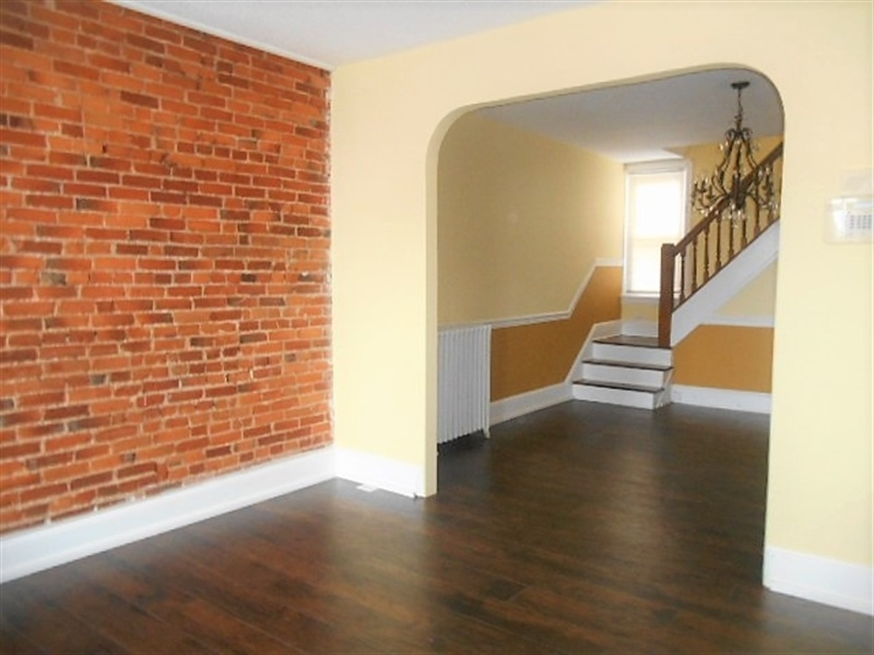 Real Estate Photography - 419 S Broom St, Wilmington, DE, 19805 - LR with Exposed Brick Wall