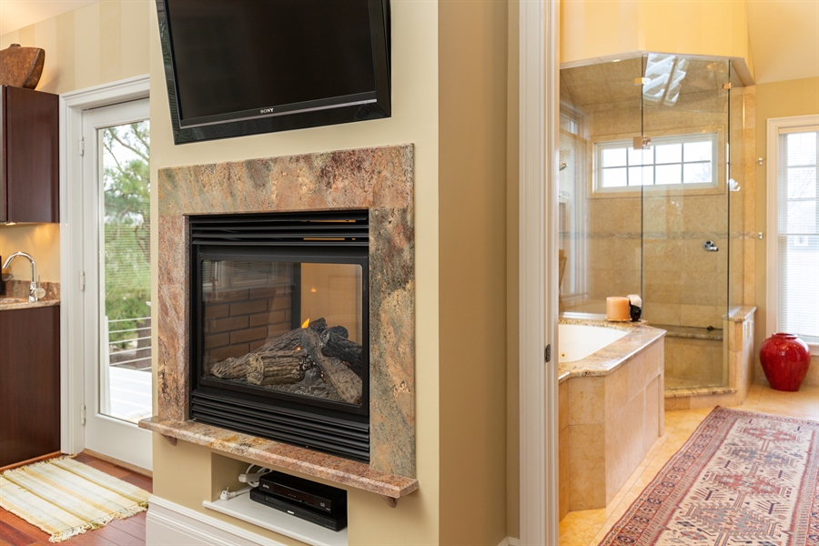 Real Estate Photography - 703 Scarborough Ave, Rehoboth Beach, DE, 19971 - Two Sided Gas Fireplace
