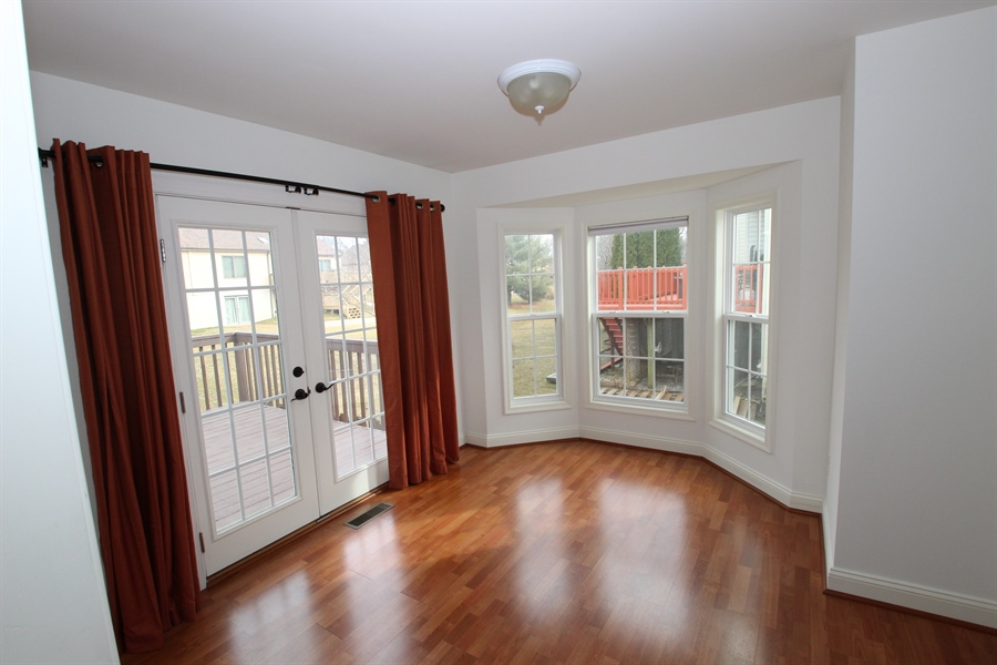 Real Estate Photography - 116 Steven Ln, Wilmington, DE, 19808 - Dining room with bay window and hardwoods