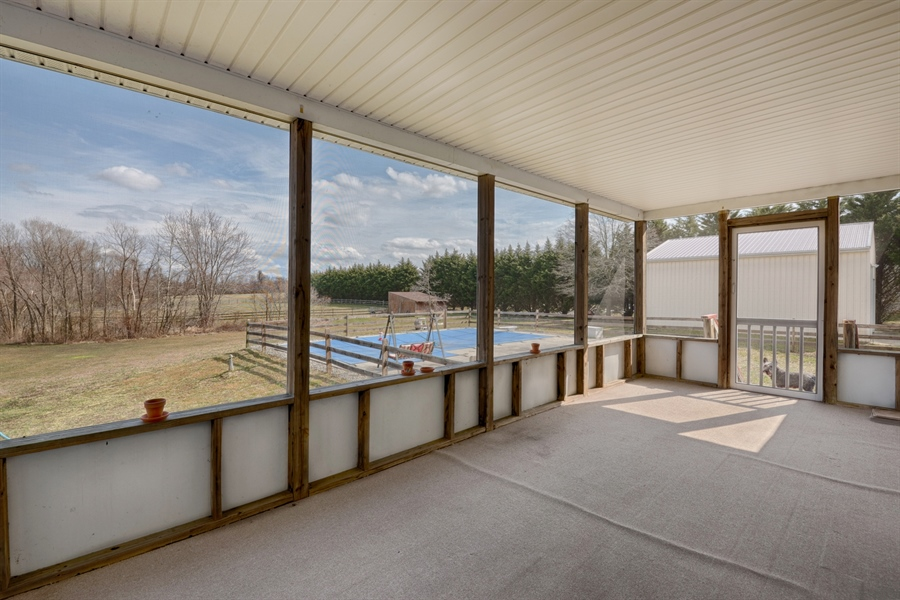 Real Estate Photography - 70 Stoney Battery Rd, Earleville, MD, 21919 - SCREENED PORCH TOWARD POOL
