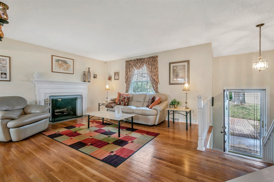 Real Estate Photography - 2500 Turnstone Dr, Wilmington, DE, 19805 - Another View Of The Living Room With Fireplace