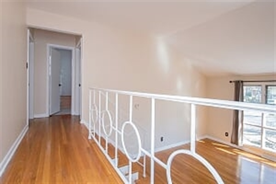 Real Estate Photography - 2208 Foote Rd, Wilmington, DE, 19803 - Open and bright upstairs hallway