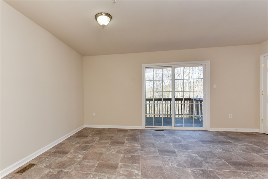Real Estate Photography - 106 Ben Boulevard, Elkton, DE, 21921 - Up to main level-17x14 Kitchen with slider to deck