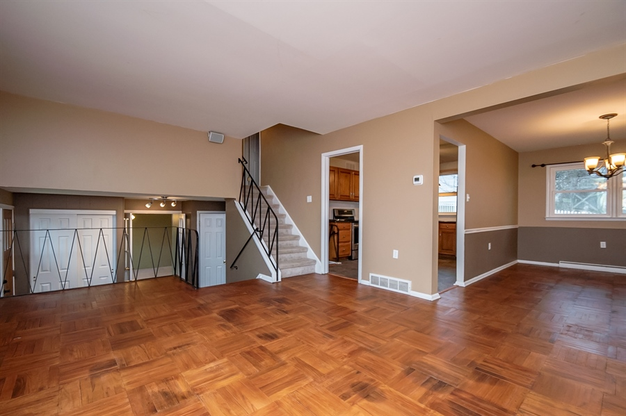 Real Estate Photography - 103 Compass Dr, Claymont, DE, 19703 - Recently Refinished Hardwoods in Living Room