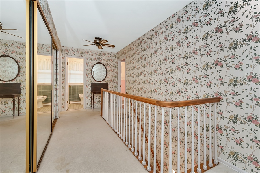 Real Estate Photography - 26 N Cliffe Dr, Wilmington, DE, 19809 - Upstairs Hallway With Extra Closets!