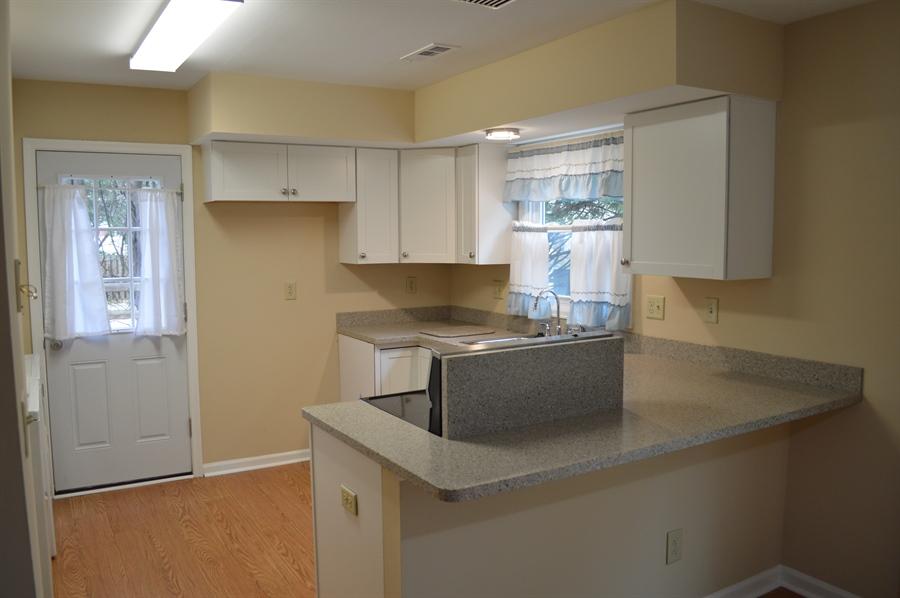 Real Estate Photography - 2 Hampton Ct, Newark, DE, 19702 - Kitchen & Dining Area w New Floors