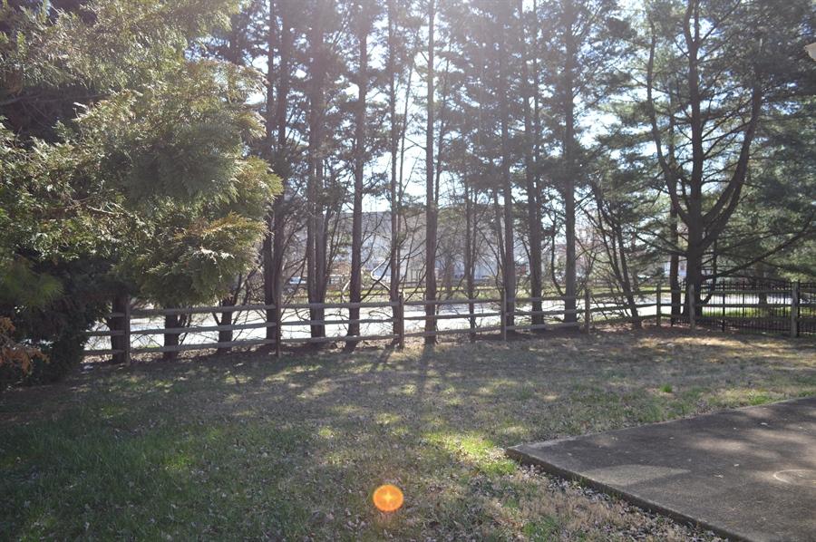 Real Estate Photography - 2 Hampton Ct, Newark, DE, 19702 - Tree Lined Fenced Rear Yard