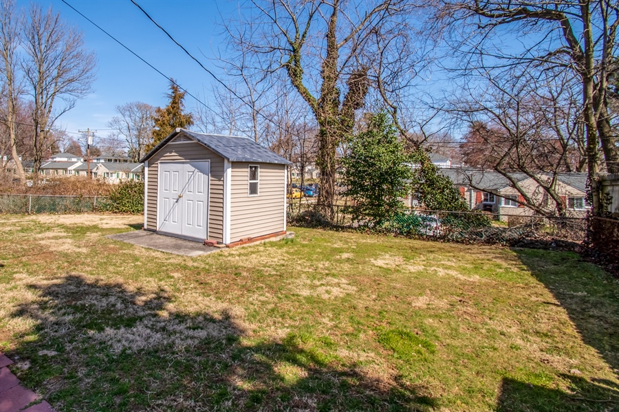 Real Estate Photography - 1013 Kendall Rd, Wilmington, DE, 19805 - Shed and Partially Fenced Flat Yard