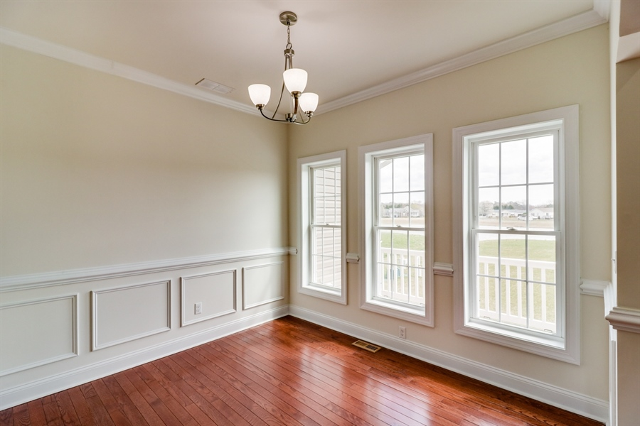Real Estate Photography - 38 Beacon Cir, Millsboro, DE, 19966 - Dining room with custom trim and molding
