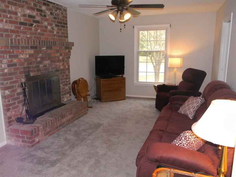 Real Estate Photography - 4 N Parkway, Elkton, MD, 21921 - Den - brick wood burning fireplace