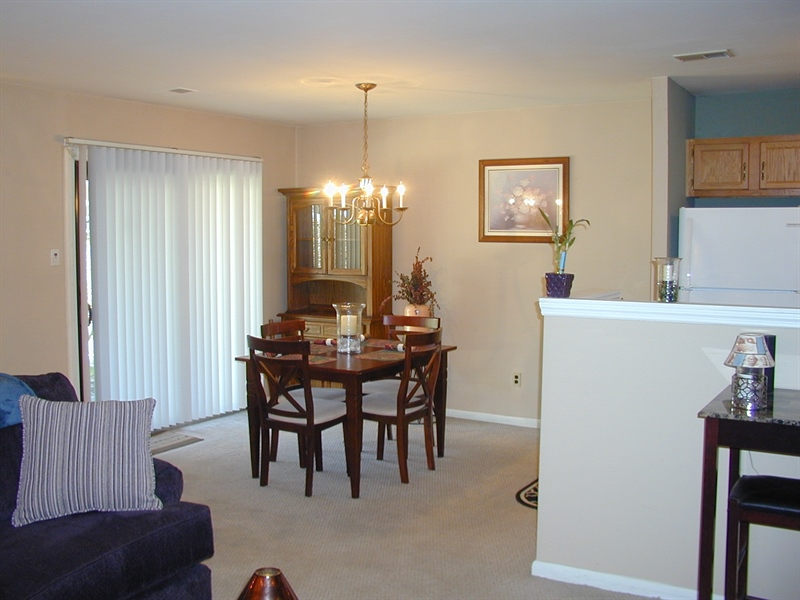 Real Estate Photography - 5036 W Brigantine Ct, Wilmington, DE, 19808 - Dining area opens to front Patio
