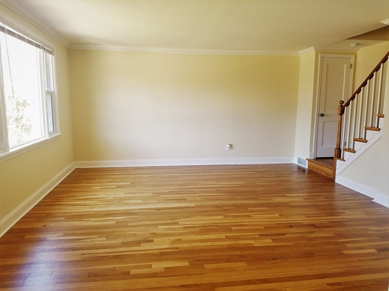 Real Estate Photography - 103 Sandra Rd, Wilmington, DE, 19803 - Living room accented with fabulous hardwood floors