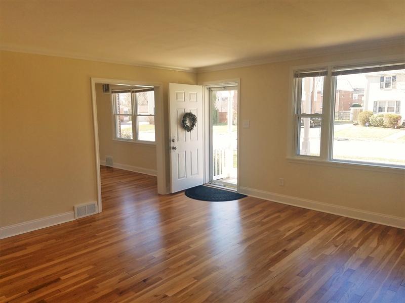 Real Estate Photography - 103 Sandra Rd, Wilmington, DE, 19803 - Living room w\ plenty of sunlight & crown molding