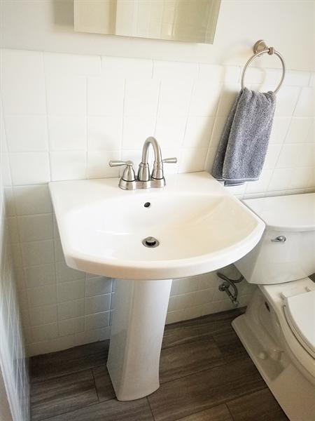 Real Estate Photography - 103 Sandra Rd, Wilmington, DE, 19803 - Updated bathroom offering a pedestal sink
