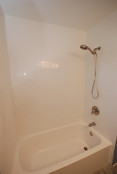 Real Estate Photography - 1001 Wagoner Dr, Wilmington, DE, 19805 - tub surrounded with subway tiles