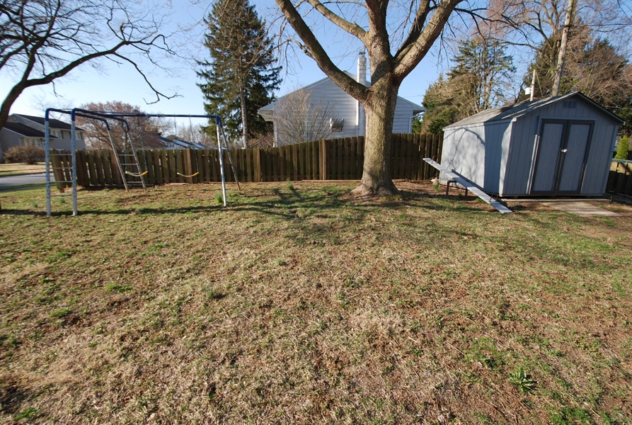 Real Estate Photography - 1001 Wagoner Dr, Wilmington, DE, 19805 - backyard with playground and shed