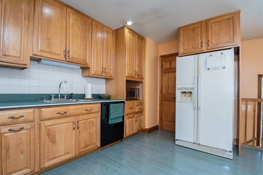 Real Estate Photography - 2415 W Eric Dr, Wilmington, DE, 19808 - There are tons of cabinets!