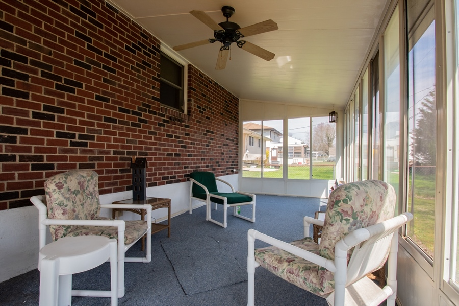 Real Estate Photography - 2415 W Eric Dr, Wilmington, DE, 19808 - Huge 3 season room spans the back of the home