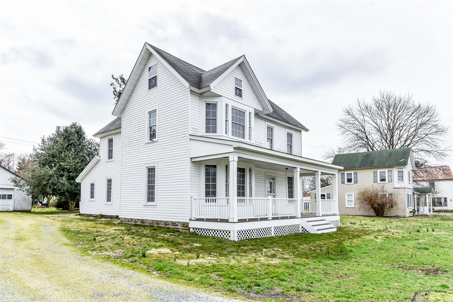 Real Estate Photography - 176 Main St, Warwick, MD, 21912 - Colonial Farmhouse with spacious rooms throughout