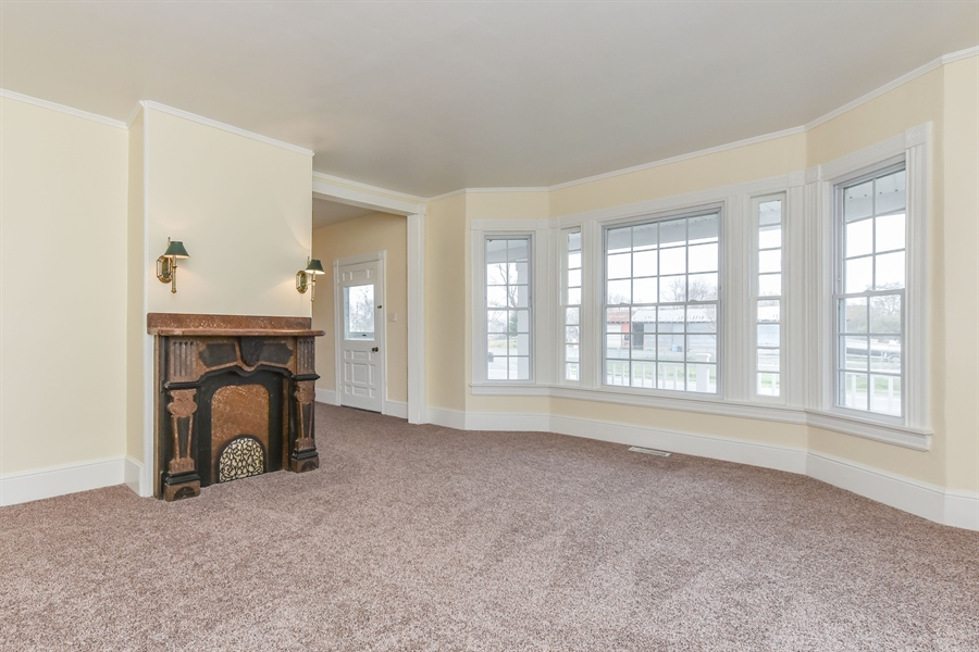Real Estate Photography - 176 Main St, Warwick, MD, 21912 - 19x16 Dining Rm, decorative mantel & lots of light